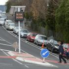A father and child cross Brown St in Dunedin on one of the city's new courtesy crossings inside...