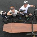 Riding in tandem with a coffin in tow to collect signatures to present to Parliament are Camilla...