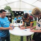 Shared site . . . Visitors at a previous Field Days event talk to staff at Environment Southland...