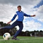 Southern United defender Andrew Cromb shoots at goal at Logan Park Turf this week. PHOTO: GERARD...