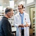 A pharmacist advises a customer about his prescription. Photo: Getty Images