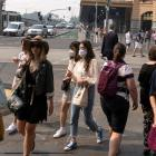 People walking through central Melbourne as the city suffers hazardous air quality on Tuesday....