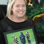 Melissa Vining holds one of her favourite photos of her late husband Blair and daughters Lilly ...