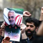 Iranian demonstrators chant slogans during a protest against the assassination of the Iranian...