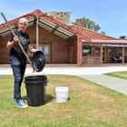Huirapa runaka (sub-tribal council) office manager John Youngson holds a recycling bucket and...