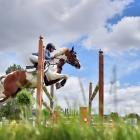Samantha Gillies, riding Junior Disco, clears the first jump in a 120cm-130cm grand prix class in...