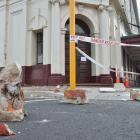 Masonry fell from the Allied Press building last night. Photo: Gerard O'Brien