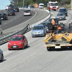 The sight of Downer contractors working on Dunedin's Southern Motorway will soon be a thing of...