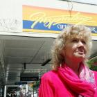 Frustrated Oamaru business owner Jan Nuttall will clean graffiti off her lower Thames St building...