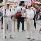 About 200 anti-5G protesters have swarmed central Christchurch with placards, hazmat suits and...