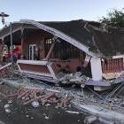 A home is seen collapsed after an earthquake in Guanica. Photo: Reuters