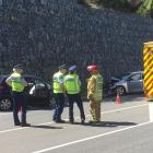 Emergency services at the crash scene this afternoon. Photo: Guy Williams