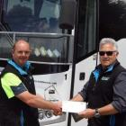 East Coast Passenger Services managing director Mike Chittock (right) presents Barry Coombes with...