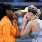 Serena Williams (left) and Caroline Wozniacki have a laugh during their first round match at the...