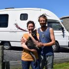 Freedom campers Sophia Christine and Nicholas Heke-Worrall hug their cat Glenny at Ocean View Recreation Reserve on Tuesday. PHOTO: SHAWN MCAVINUE