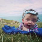 FIRST PRIZE: Ruth Mountfort (5 months) gives her visiting whanau a tour of Tunnel Beach. PHOTO:...