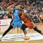 Taipans guard DJ Newbill drives at Breakers forward Tom Abercrombie. Photo: Getty Images