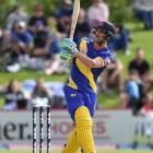 Otago opener Hamish Rutherford follows the flight of a six during his side's Super Smash twenty20...