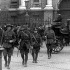 Crossing the Trinity College Green after the Easter Rising ended are New Zealand soldiers (from...