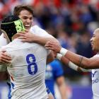 France's Gregory Alldritt celebrates scoring their third try with Antoine Dupont and Gael Fickou....