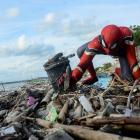 Dressed as Spider-Man, Rudi Hartono collects rubbish at a beach in Pare-Pare, South Sulawesi...