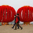 People wearing face masks walk in Beijing's Longtan Park. Photo: Reuters