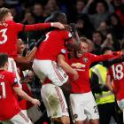 Manchester United players celebrate their second goal against Chelsea. Photo: Reuters