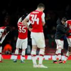 Arsenal players react after their match against Olympiakos Piraeus. Photo: Reuters