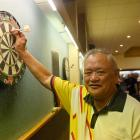Ron Te Moananui, of Dunedin, checks his shot at the darts competition at the South Dunedin Town...