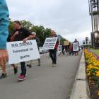 Several hundred people marched along East Street on Saturday, protesting at the next wave of...