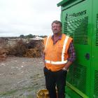 Greg Donaldson alongside his current biomass incinerator at the Ashburton Eco Park.