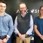 Arrowsmith Law director Greg Martin (centre) with new recruits Shea Thompson and Caitlin Hooft.