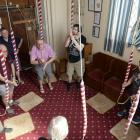 Preparing to ring a ''peal'', in the making for many months, are (clockwise from left) Mary...