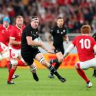 Brodie Retallick carries the ball for the All Blacks against Wales in the bronze final at last...