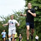 Shay Veitch crosses the line yesterday to win the University Clocktower race ahead of second...
