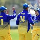 Otago Volts players (from left) Josh Finnie, Matthew Bacon and Mitch Renwick celebrate the wicket...