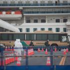 Former passengers of the Diamond Princess cruise ship leave after spending weeks on board in...