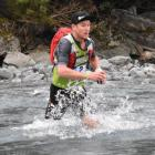 Dougal Allan works his way through a stream at last year's Coast to Coast event. PHOTOS: WAYNE...