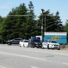 Police attend a minor crash at the Mt Iron intersection yesterday. PHOTO: MARK PRICE