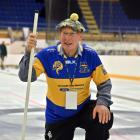 Edwin Harley with the essentials for a good game of curling. Photo: Linda Robertson