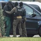 One of the 12 arrested men is brought to the Federal Supreme Court in Karlsruhe, Germany. Photo: AP