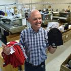 Otago Knitwear director Geoff Keogh with one of the Edmund Hillary Collection beanies...