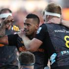 Te Toiroa Tahuriorangi of the Chiefs (C) celebrates his try during the round 2 Super Rugby match...