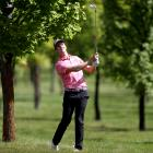 Leading New Zealander Harry Bateman plays an approach shot at Millbrook during the first round of...