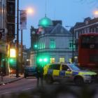 Police is seen near a site where a man was shot by armed officers in Streatham. Photo: Reuters