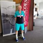 Dave Meredith has won the national singles, men's doubles and mixed doubles titles in his age group.