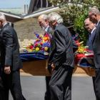 Mike Moore's casket is carried into the service in Auckland. Photo: RNZ
