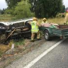 Firefighters at the scene of a single-vehicle crash in Homestead Rd, at Weston, inland from...