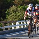 Cromwell's Nigel Lines leads Invercargill's Cameron Rogerson over the Taipo River bridge on the...