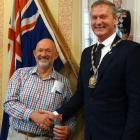Peter Ellis (left) is congratulated by Waitaki Mayor Gary Kircher after being sworn in as the...